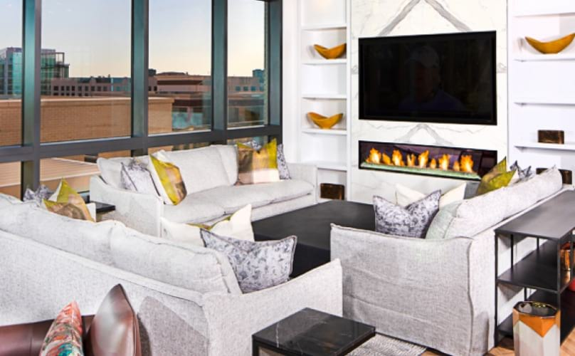 lounge with large windows - seating and fireplace - ballston apartments arlington va j sol