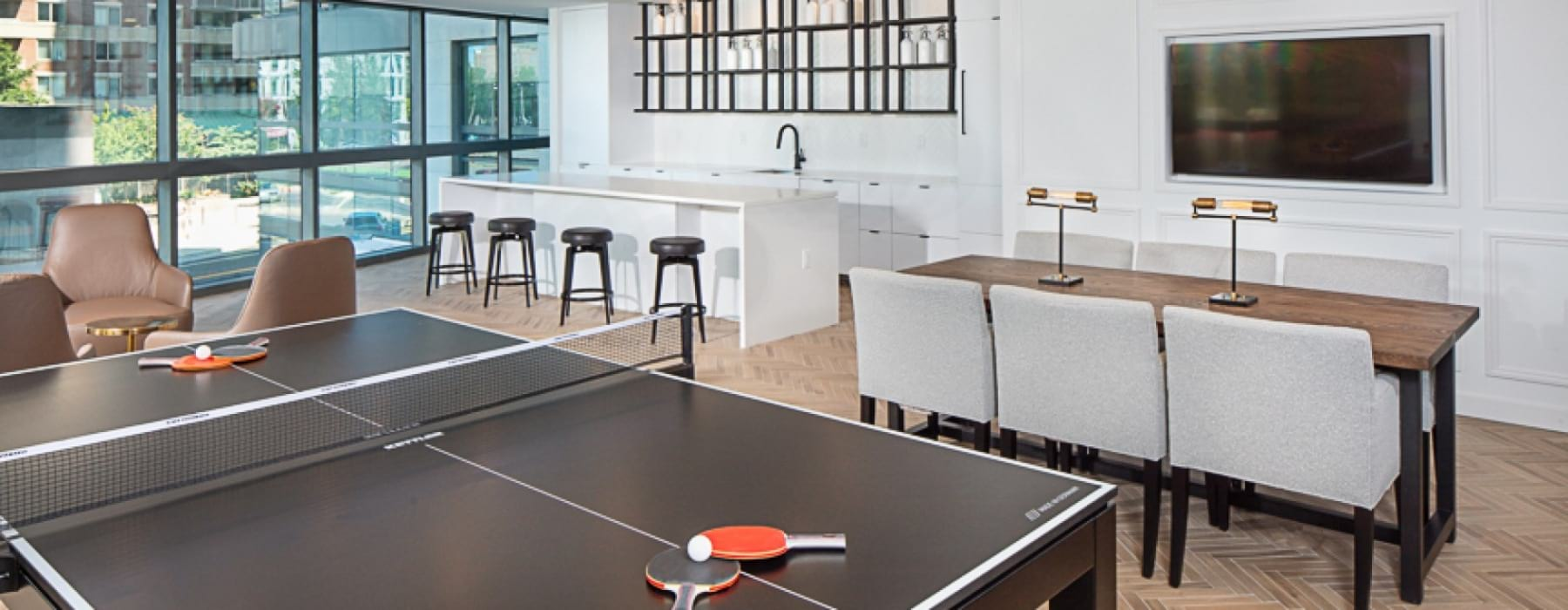 lounge with seating, ping pong and bar area - j sol luxury apartments ballston metro arlington va