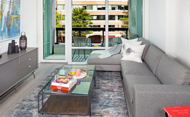 Living Area With Sofa And Coffee Table At J Sol Apartments In Arlington, VA