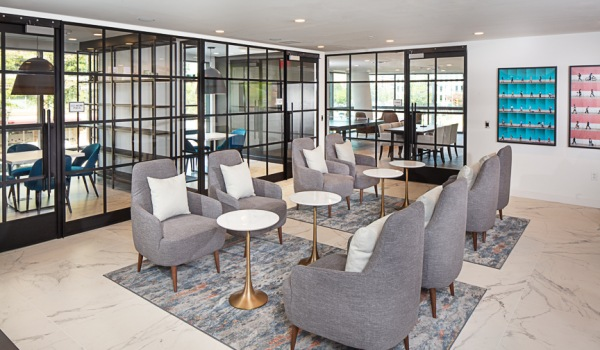 Lounge With Social Seating And Seperate Work Pods At J Sol Apartments In Arlington, VA