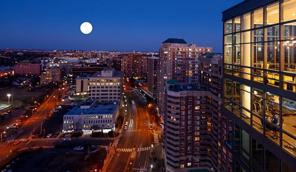 view of a full moon over washington dc from j sol arlington luxury apartment building